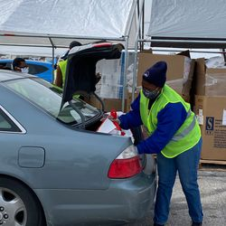 Latter-day Saint Charities provided 40,000 pounds of food that was repackaged and then distributed by 75 volunteers from The Church of Jesus Christ of Latter-day Saints, additional community volunteers and members of the National Guard in Florissant, Missouri, on Monday, January 18, 2021.