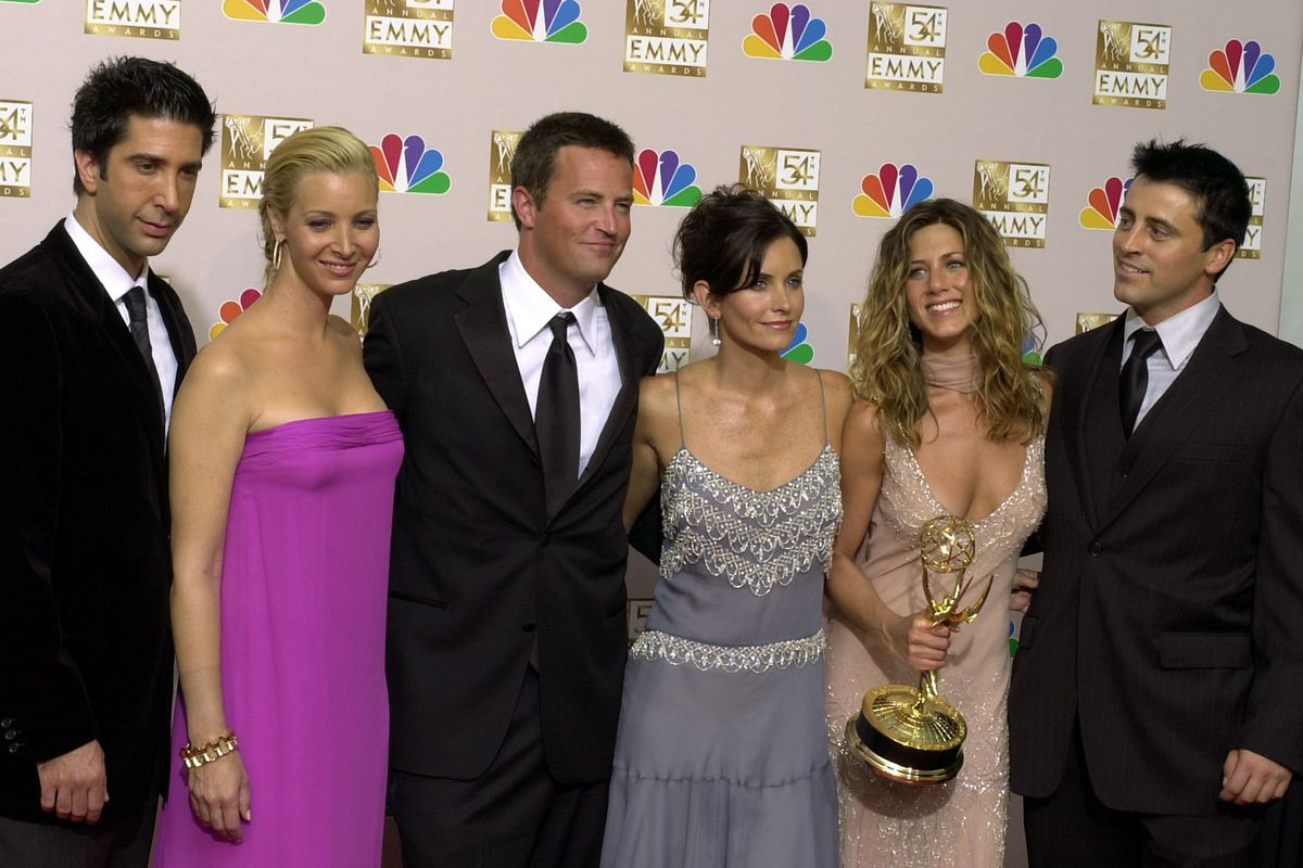 David Schwimmer (from left) Lisa Kudrow, Matthew Perry, Courteney Cox, Jennifer Aniston and Matt LeBlanc pose in the press room with the award for outstanding comedy series at the 54th annual Primetime Emmy Awards in Los Angeles in 2002.