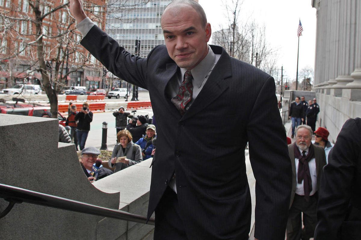 FILE - This Feb. 28, 2011 file photo, shows environmental activist Tim DeChristopher waving to supporters at the Frank E. Moss Federal Courthouse in Salt Lake City. DeChristopher is giving up appeals of his conviction for bidding on oil-and-gas parcels he