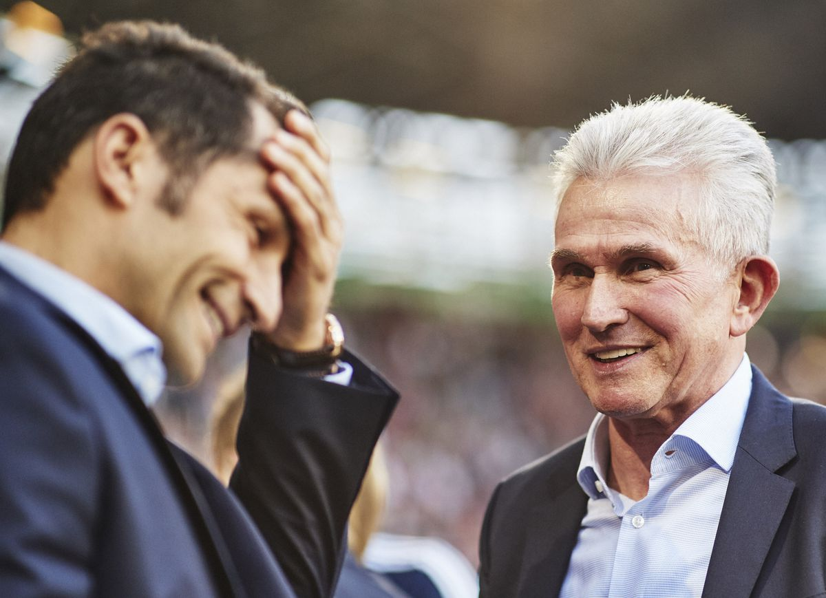 AUGSBURG, GERMANY - APRIL 07: Jupp Heynckes head coach of Bayern Munich is congratulated by Hasan Salihamidzic Bayner Munich Sports Director after victory in the Bundesliga match between FC Augsburg and FC Bayern Muenchen at WWK-Arena on April 7, 2018 in Augsburg, Germany.
