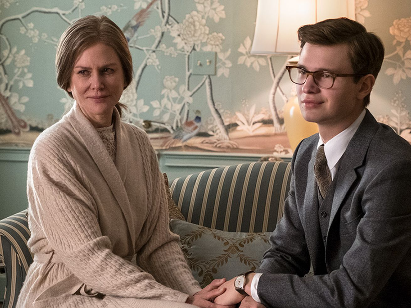 """Nicole Kidman and Ansel Elgort sit together on a sofa in the movie """"The Goldfinch."""""""