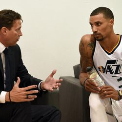 Utah Jazz guard George Hill speaks with head coach Quin Snyder during Media Day at Zions Bank Basketball Center in Salt Lake City on Monday, Sept. 26, 2016.