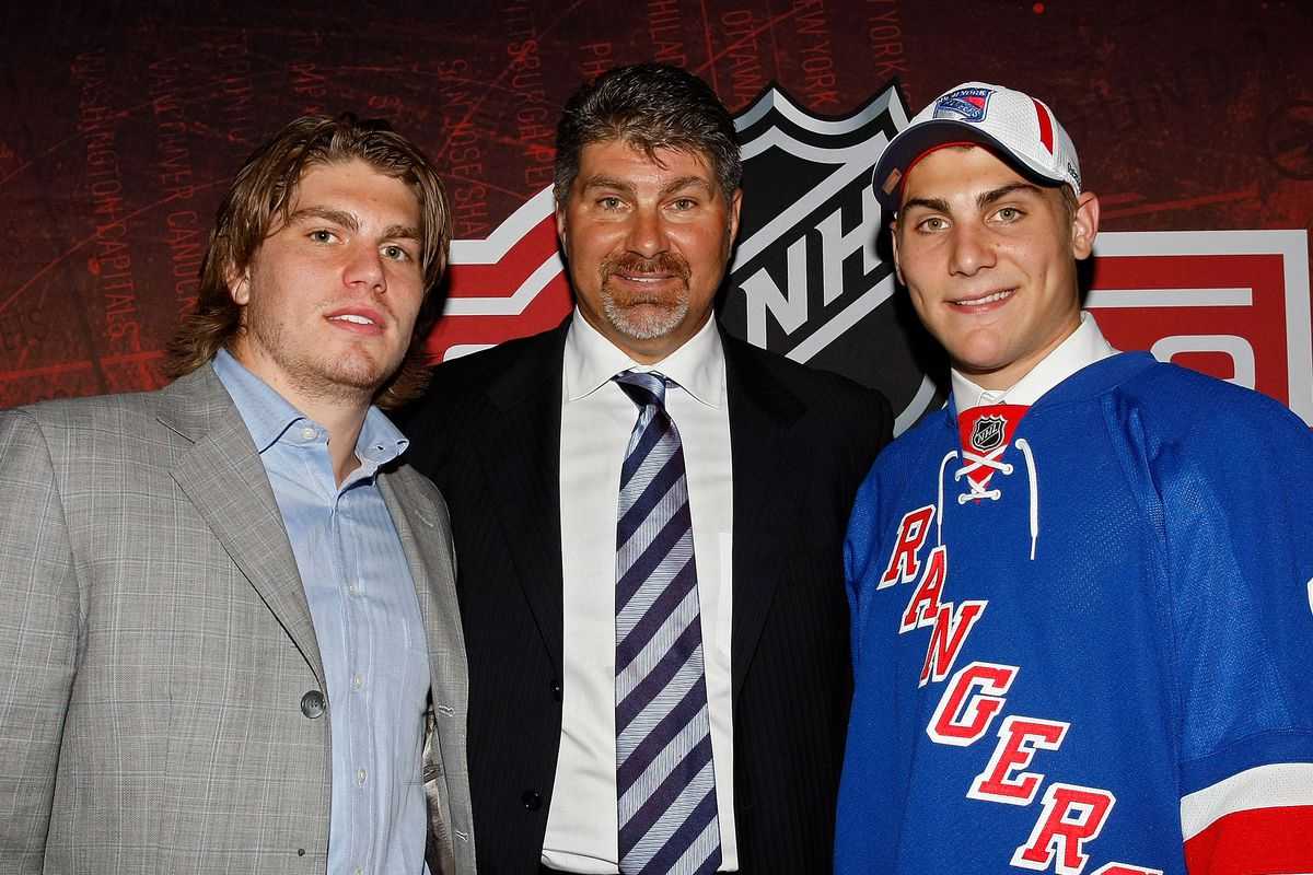 Some Bruins old-timer and his kids... Chris, Ray, and Ryan Bourque.