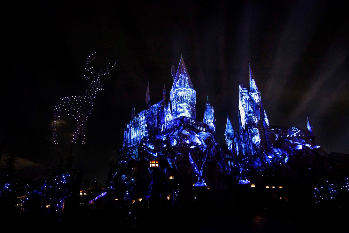 Dozens of aerial drones form a patronus at The Wizarding World of Harry Potter's Dark Arts at Hogwarts show in Universal Studios Hollywood.