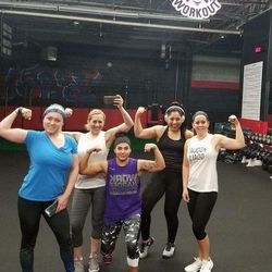 Memorez Rackley, far right, who was killed in a shooting in Sandy on Tuesday along with her 6-year-old son Jase, is shown here with a group of workout friends at Pure Workout in Murray.
