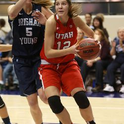 Utah's Emily Potter moves around BYU's Jennifer Hamson during a women's basketball game at the Marriott Center in Provo on Saturday, Dec. 14, 2013. Utah won in double overtime 82-74.