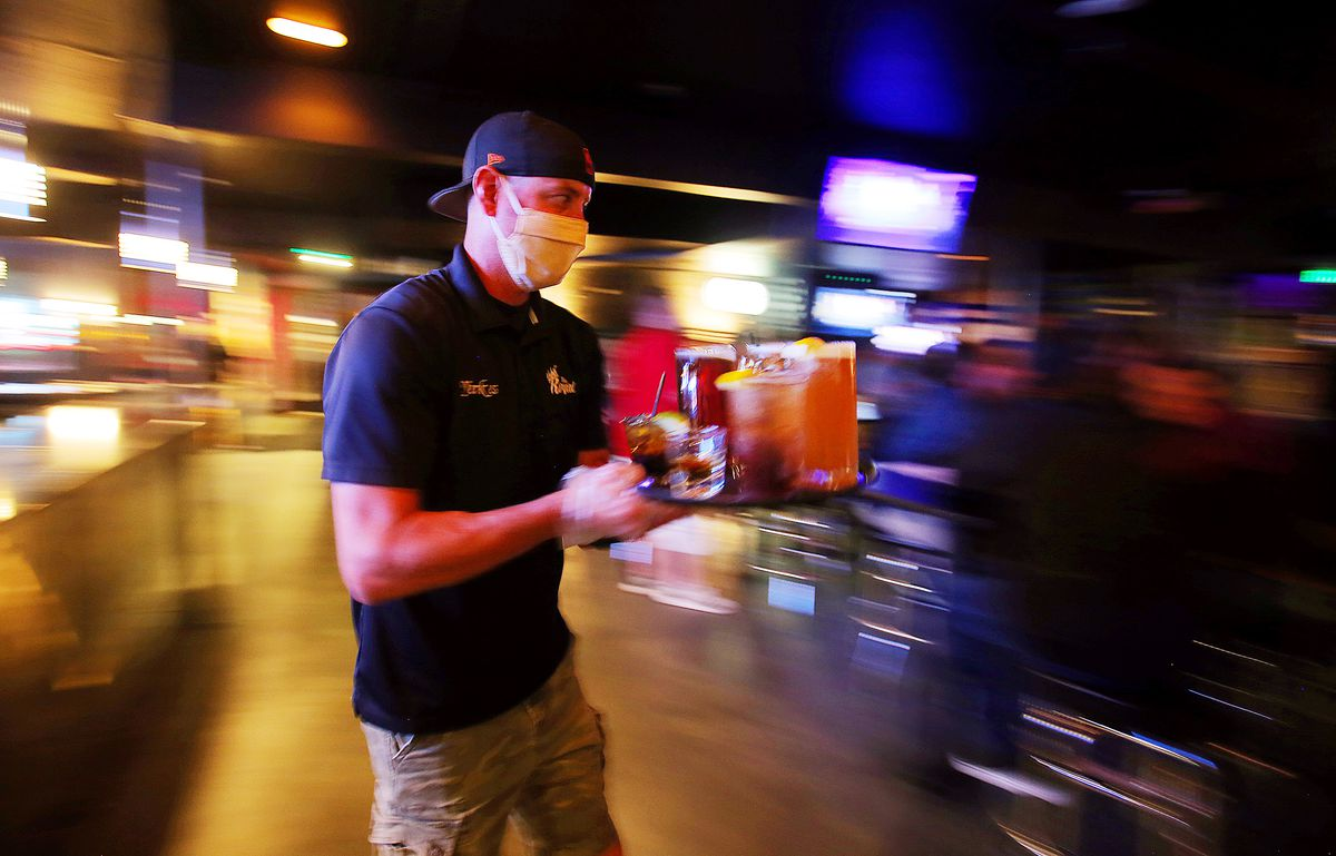 Jeff Yerkes carries drinks to customers at The Royal in Murray on Friday, May 22, 2020.