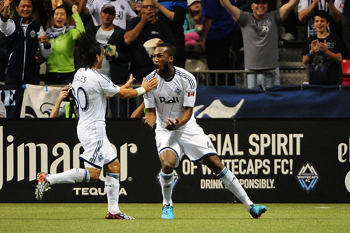 Kendall Waston (R) and Mauro Rosales celebrate Waston's first goal as a Whitecap
