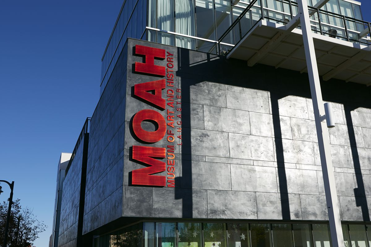 The building for the Lancaster Museum of Art and History, with large red sign that reads MOAH.
