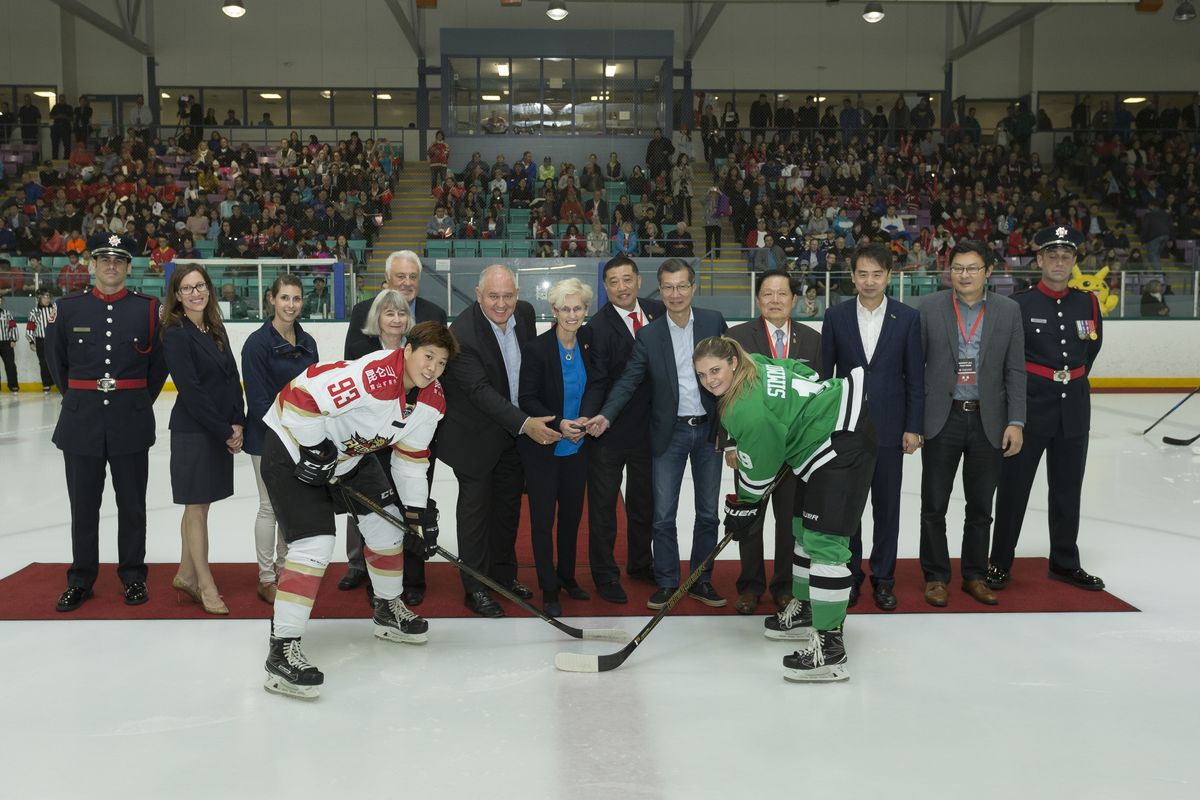 Kunlun Red Star defender Zhixin Liu (93) faces off against Dania Simmonds (19) of the Markham Thunder during the ceremonial puck drop prior to their October 21 game.