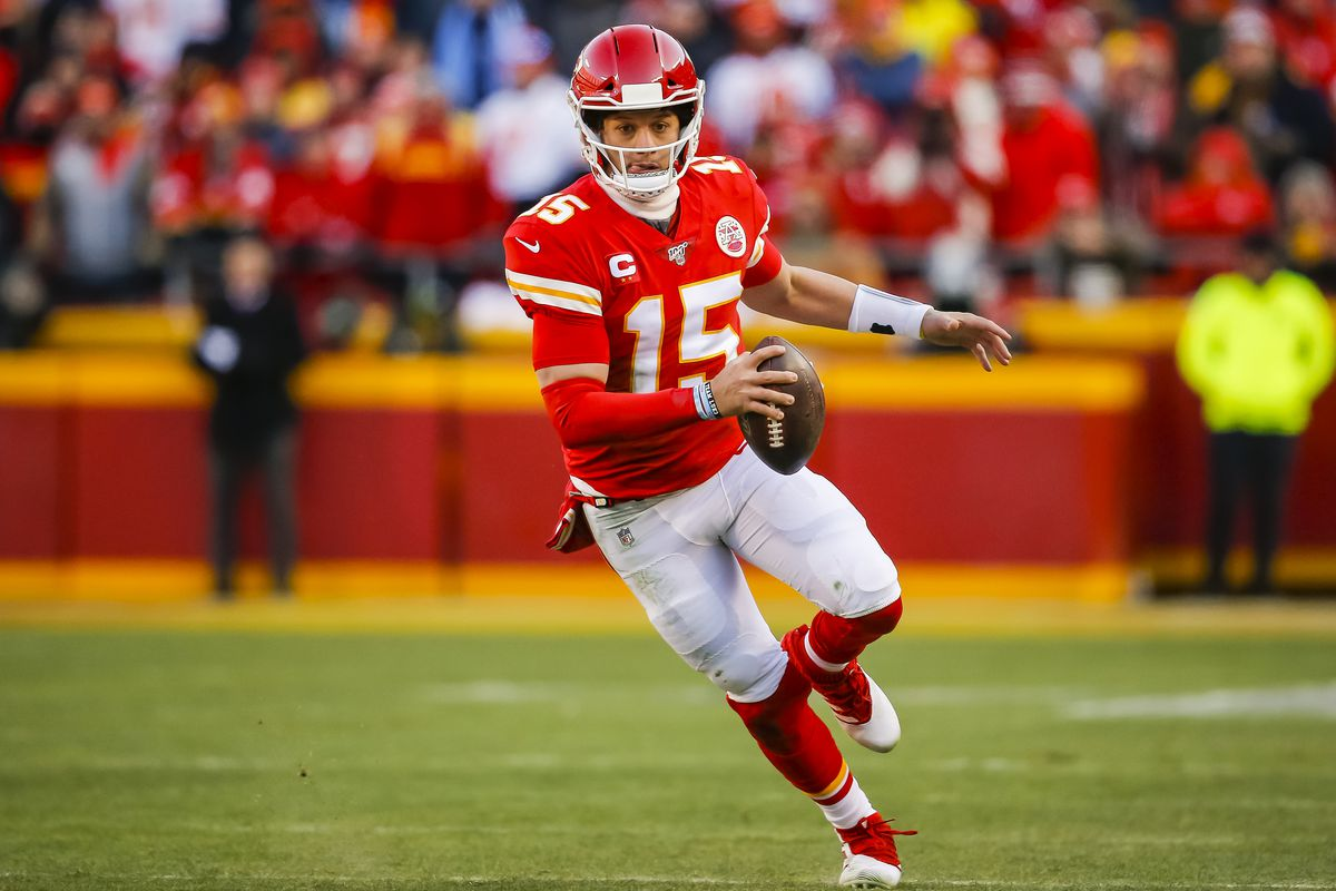 Patrick Mahomes #15 of the Kansas City Chiefs runs with the football in the second quarter of the AFC Championship game against the Tennessee Titans at Arrowhead Stadium on January 19, 2020 in Kansas City, Missouri.