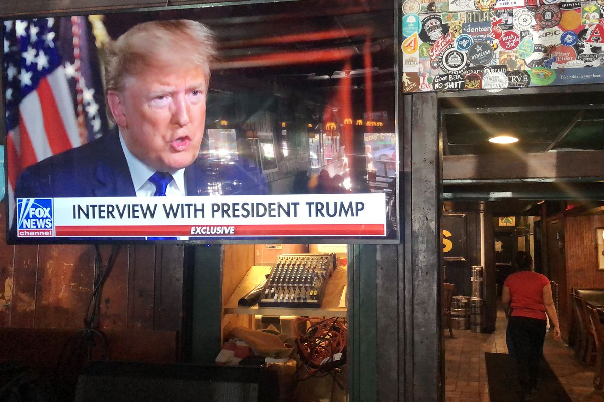 Trump on TV in a bar.