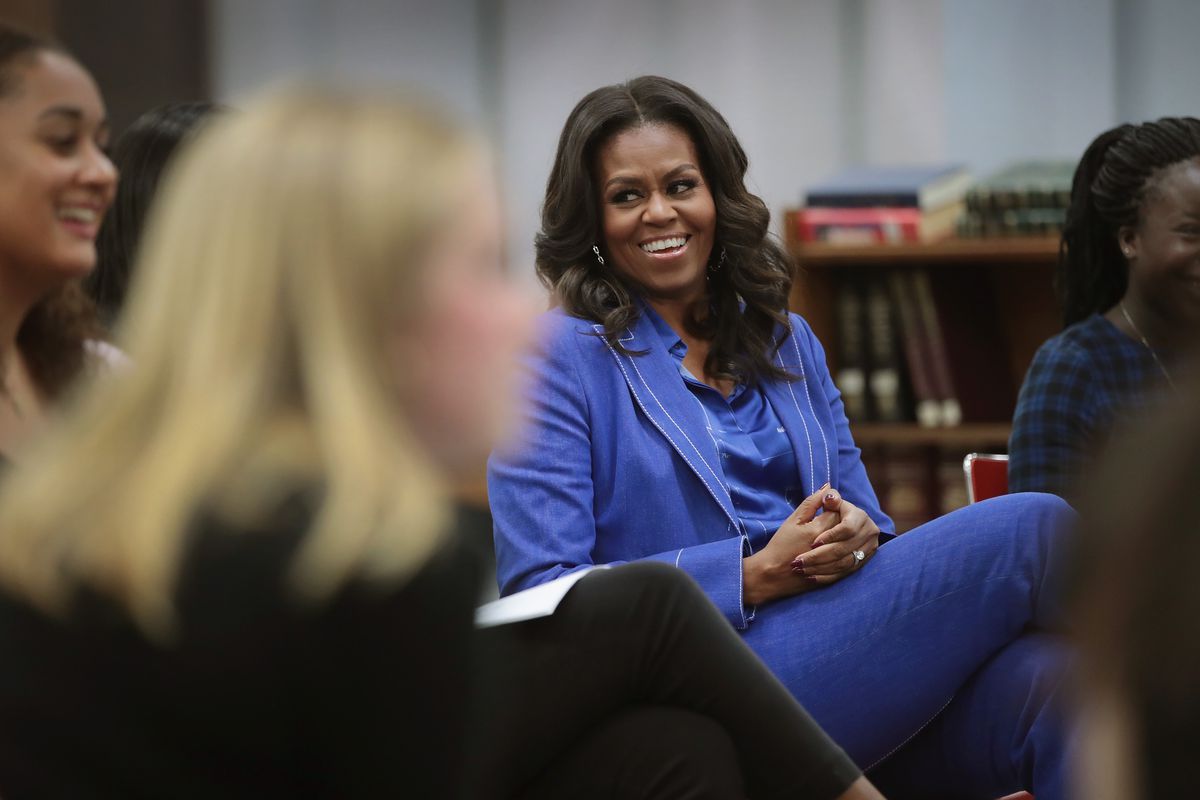 Michelle Obama Reads From Her Book To Girls From Her Old High School In Chicago