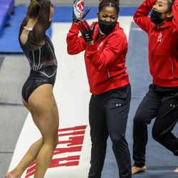 Utah's gymnasts celebrate as Utah and UCLA compete in a gymnastics meet at the Huntsman Center in Salt Lake City on Friday, Feb. 19, 2021.