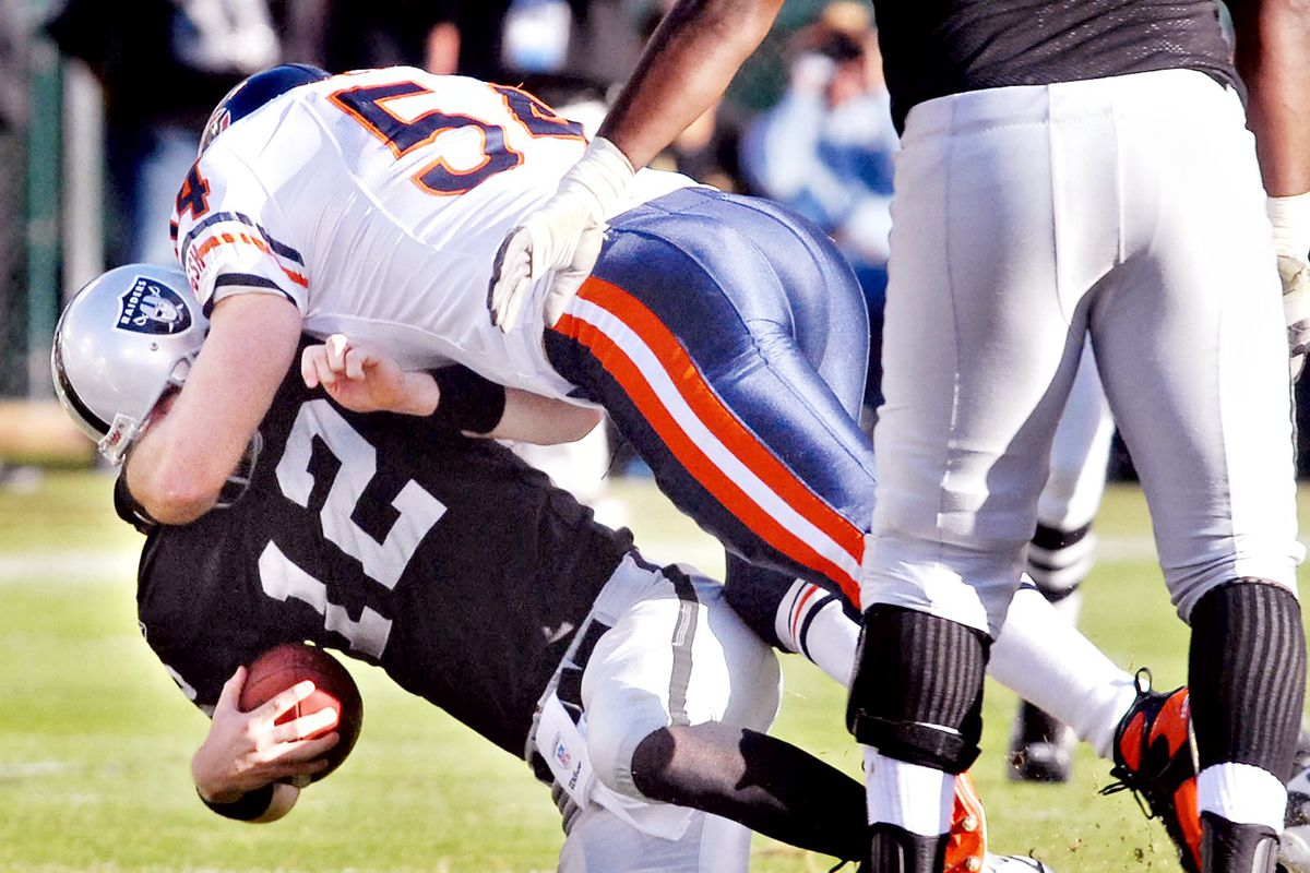 Quarterback Josh McCown is sacked by the Chicago Bears Brian Urlacheer as the Raider lose, this time to the Chicago Bears 17-6 on Sunday, November 11, 2007 at McAfee Coliseum in Oakland, Calif. Dan Honda/Contra Costa Times)
