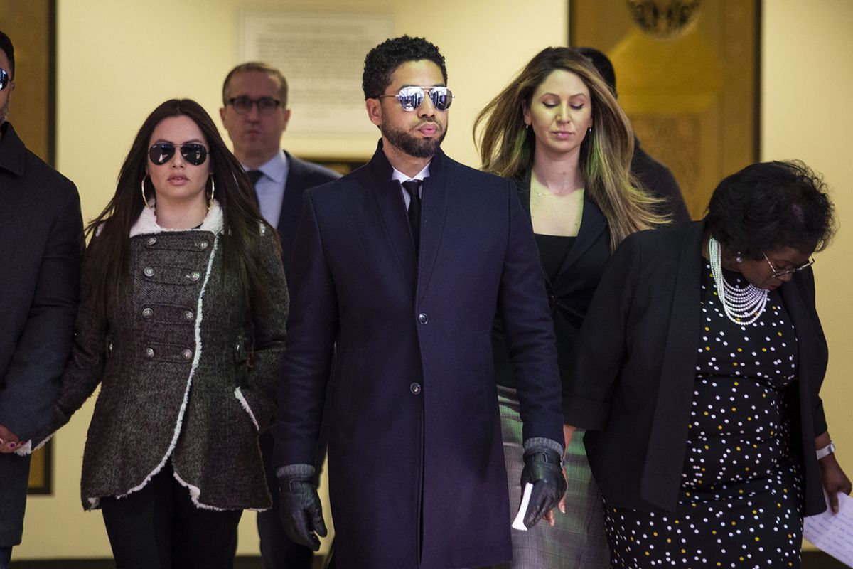 Jussie Smollett leaves court after charges were dropped earlier this year.