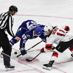 Syracuse Crunch Mitchell Stephens (67) wins a face-off against Binghamton Devils Brett Seney (11) in American Hockey League (AHL) action at the Floyd L. Maines Veterans Memorial Arena in Binghamton, New York on Friday, October 19, 2018. Syracuse won 4-0.