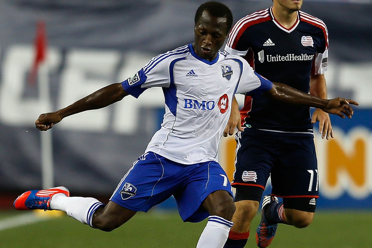 FOXBORO, MA - AUGUST 12:  Sanna Nyassi #11 of the Montreal Impact works his way around Kelyn Rowe #11 of the New England Revolution at Gillette Stadium on August 12, 2012 in Foxboro, Massachusetts. (Photo by Jim Rogash/Getty Images)