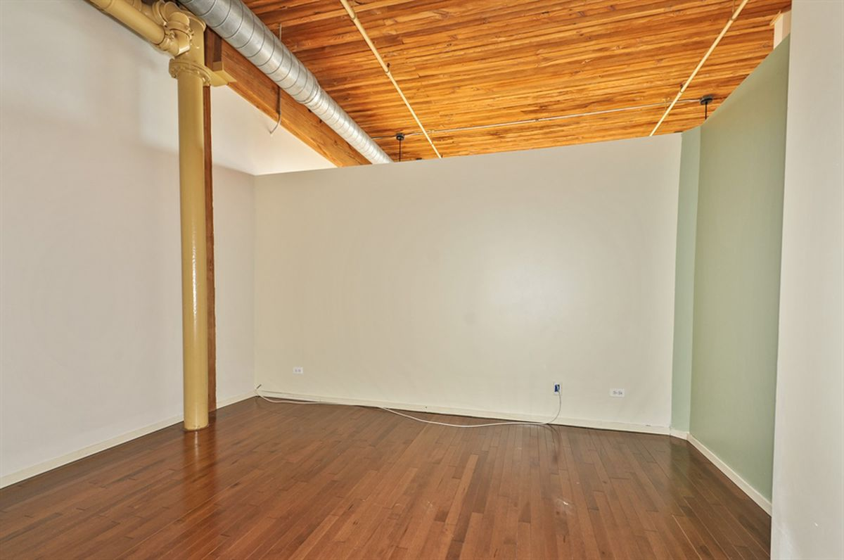 Solid South Loop timber loft can be had for $249K - Curbed Chicago