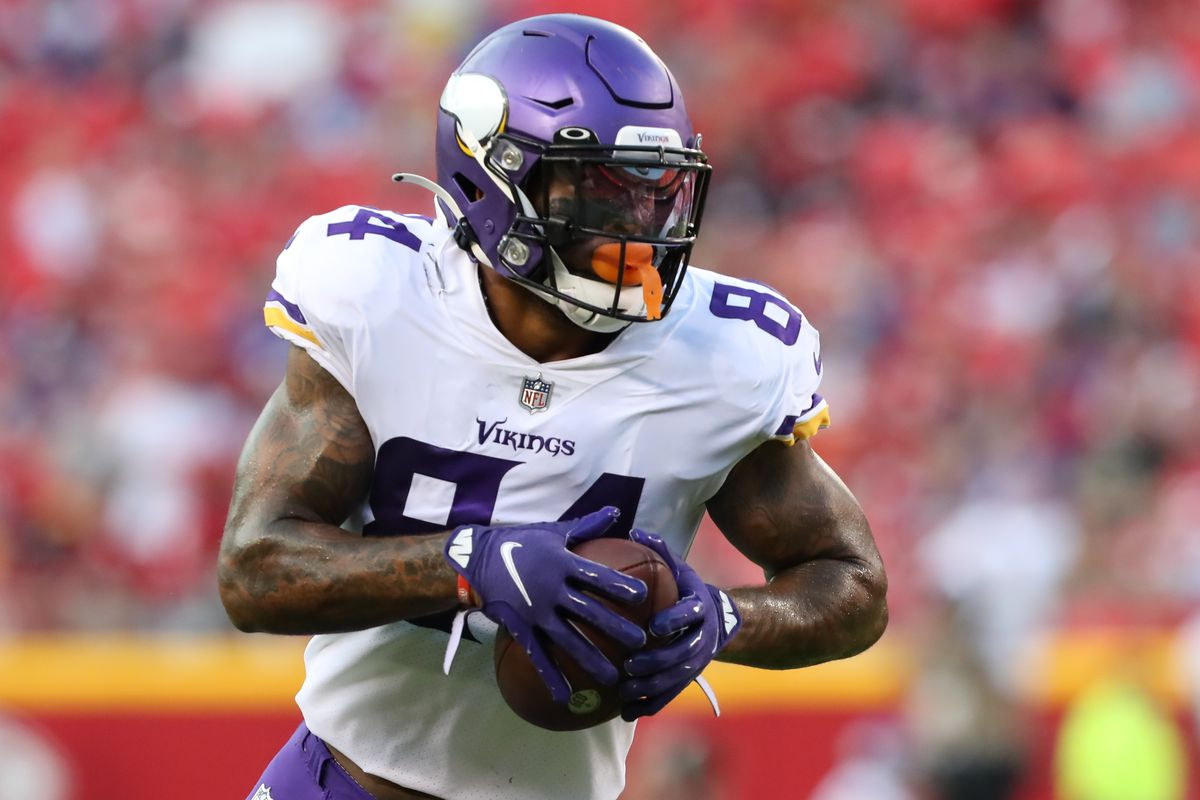 Minnesota Vikings tight end Irv Smith (84) runs after a catch in the first quarter of an NFL preseason game between the Minnesota Vikings and Kansas City Chiefs on Aug 27, 2021 at GEHA Field at Arrowhead Stadium in Kansas City, MO.