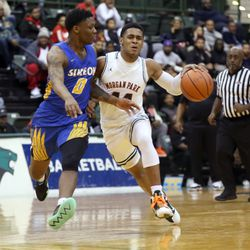 Morgan Park's Adam Miller (44) holds off Simeon's Kejuan Clements (0) in CPS semi final game at Chicago State University, Friday, February 15, 2019. | Kevin Tanaka/For the Sun Times
