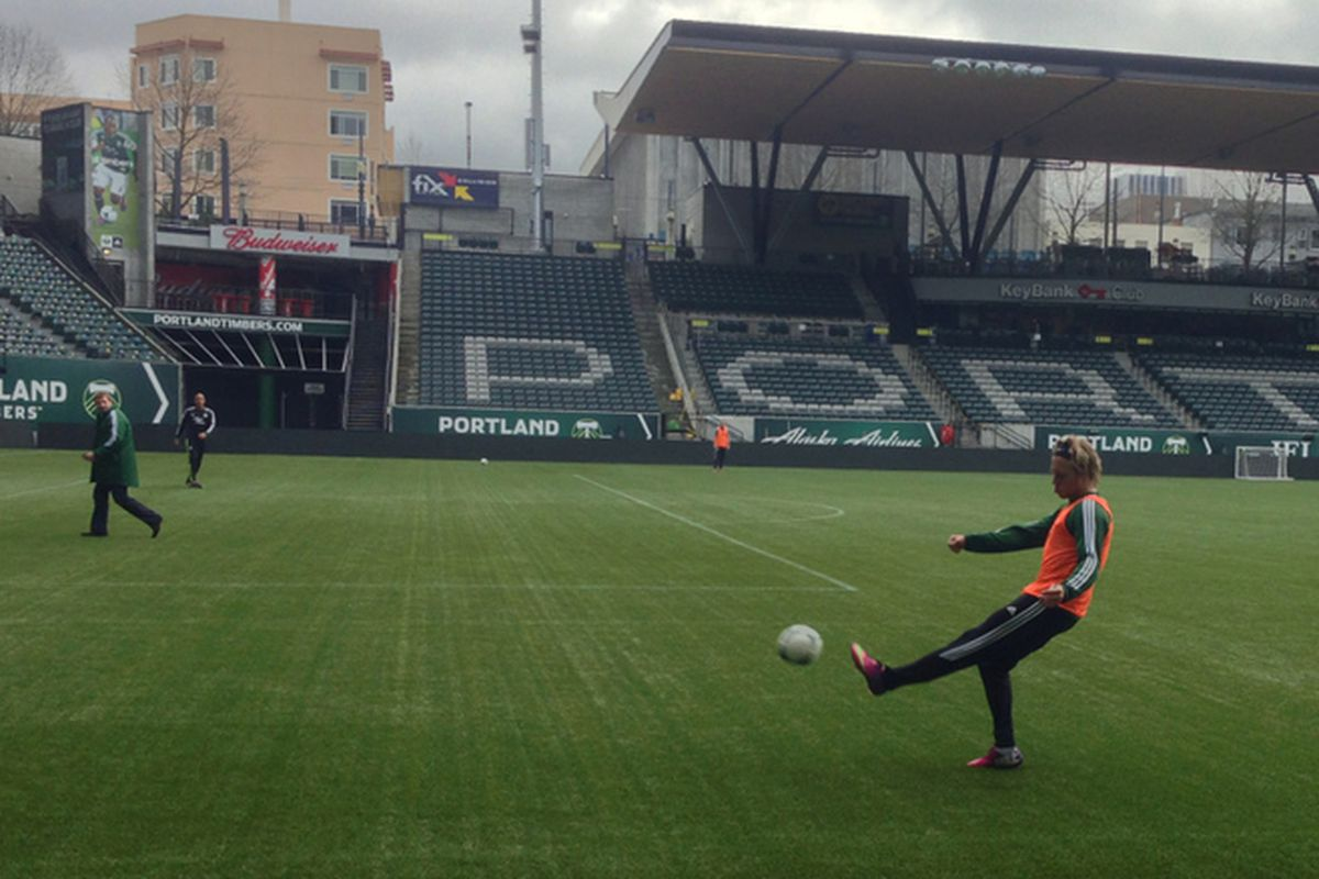 Michael Harrington practices crosses after training has wrapped up. Gavin Wilkinson and Pablo Moreira in the background.