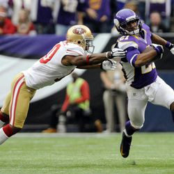 Minnesota Vikings cornerback Josh Robinson, right, runs from San Francisco 49ers wide receiver Kyle Williams, left, after intercepting a pass during the second half of an NFL football game Sunday, Sept. 23, 2012, in Minneapolis. The Vikings won 24-13.
