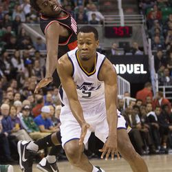 Portland Trail Blazers forward Al-Farouq Aminu (8) reaches to block as Utah Jazz guard Rodney Hood (5) moves up the court as the Jazz and Trail Blazers play in a preseason game in Salt Lake City at Vivint Smart home Arena on Wednesday, Oct. 19, 2016.