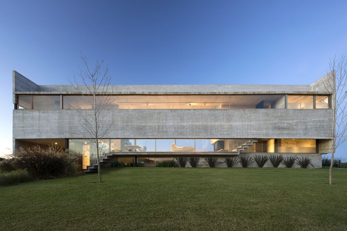 Front of concrete and glass house.