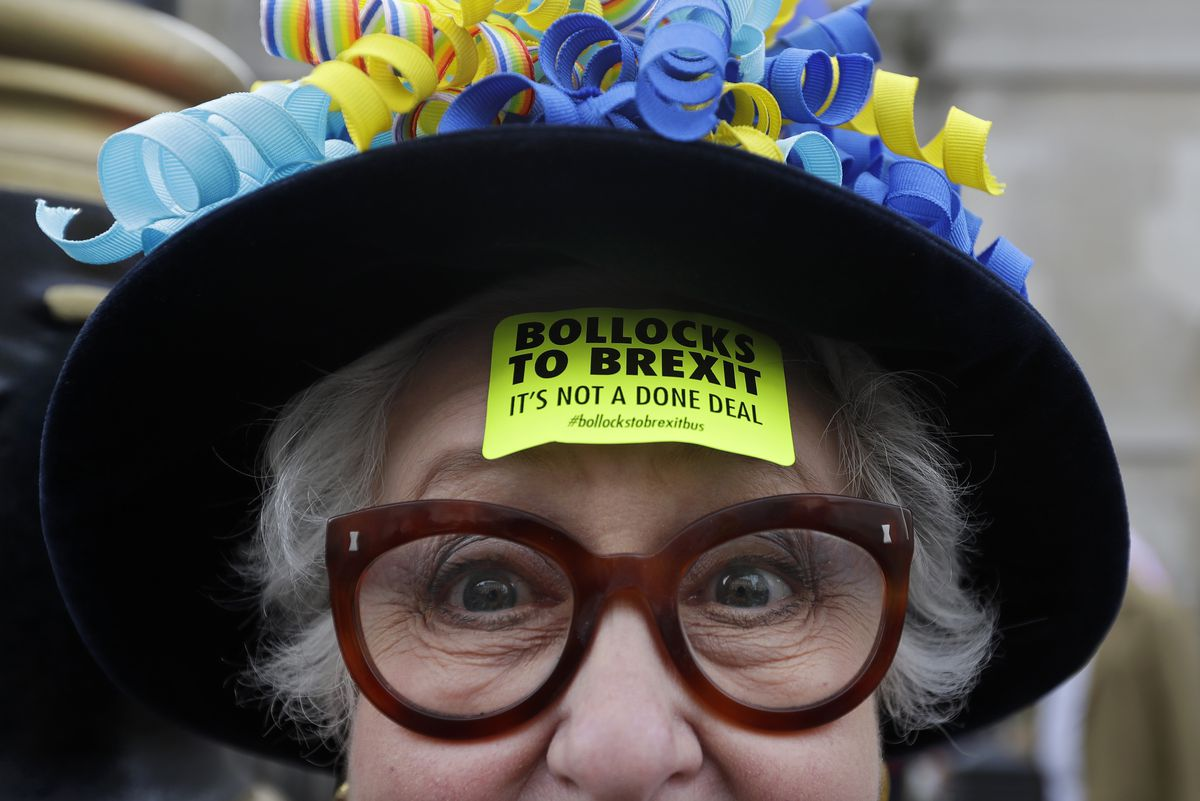 "A demonstrator wears a sticker on her forehead that reads ""Bollocks to Brexit"" during the People's Vote anti-Brexit march in London on March 23, 2019."