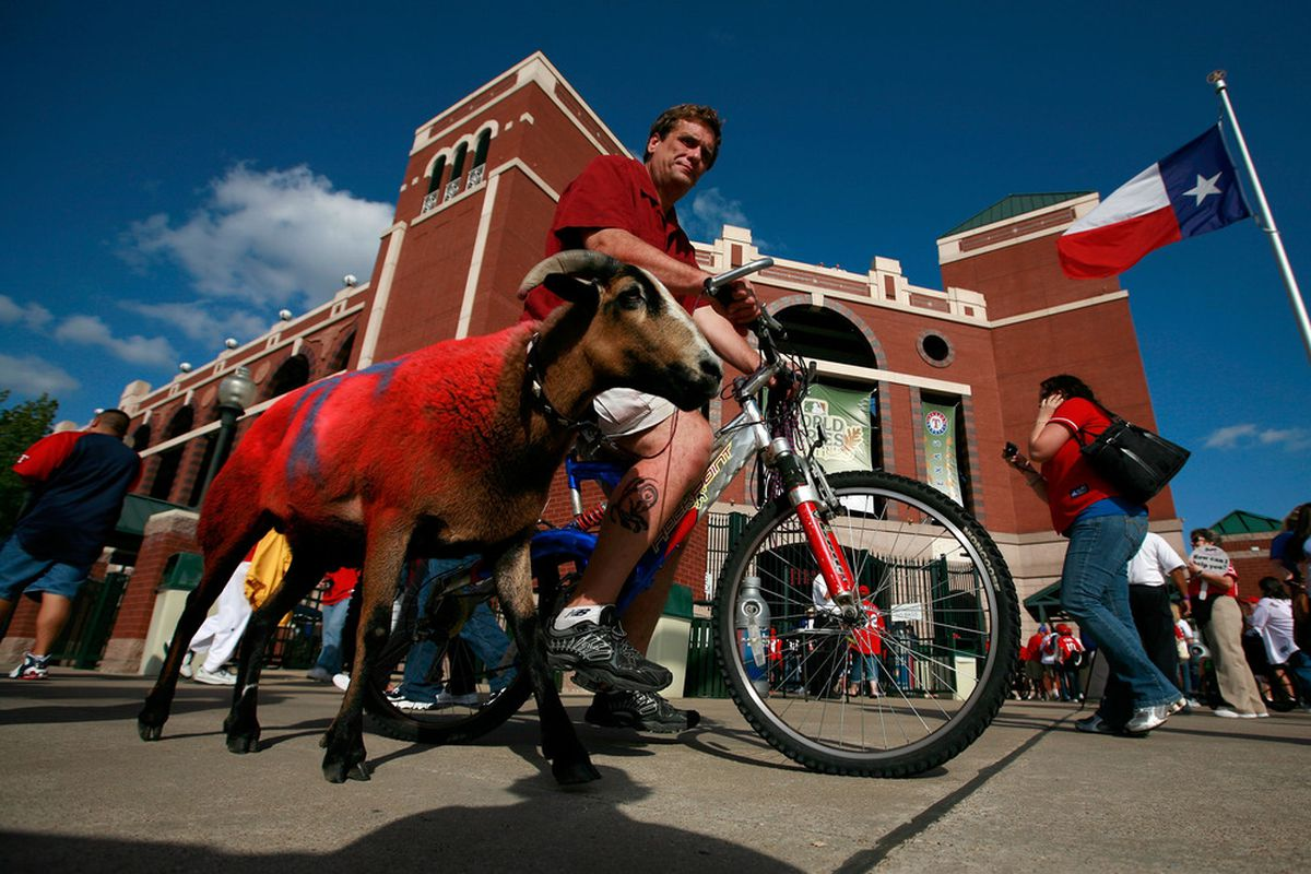 ARLINGTON, TX - OCTOBER 22:  A Texas Rangers fan waits outside the stadium before Game Three of the MLB World Series at Rangers Ballpark in Arlington on October 22, 2011 in Arlington, Texas.  (Photo by Tom Pennington/Getty Images)