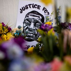 A poster and flowers adorn a memorial to George Floyd in Salt Lake City after a jury found former Minneapolis police officer Derek Chauvin guilty in the killing of George Floyd on Tuesday, April 20, 2021.
