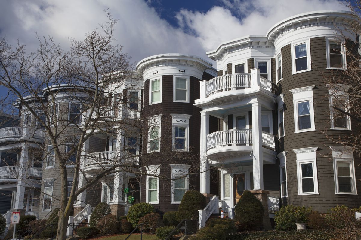A row of close-together three-story rowhouses.