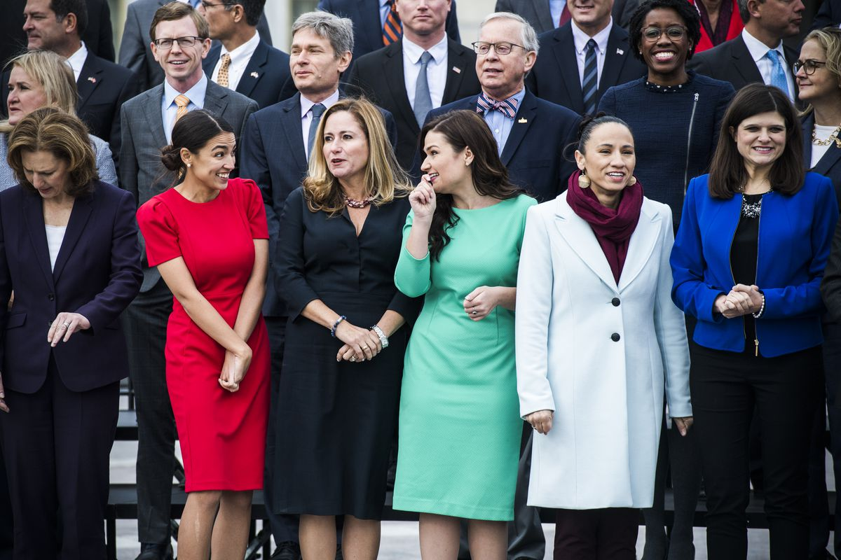 Reps.-elect Alexandria Ocasio-Cortez, (D-NY), Debbie Mucarsel-Powell, (D-FL), Abby Finkenauer, (D-IA), Sharice Davids, (D-KS), Haley Stevens, (D-MI), and other members of the incoming freshman class, pose for a photo on November 14, 2018