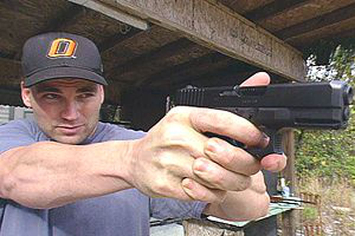 Luke Scott doesn't want MLB telling him where he can't take his guns.
