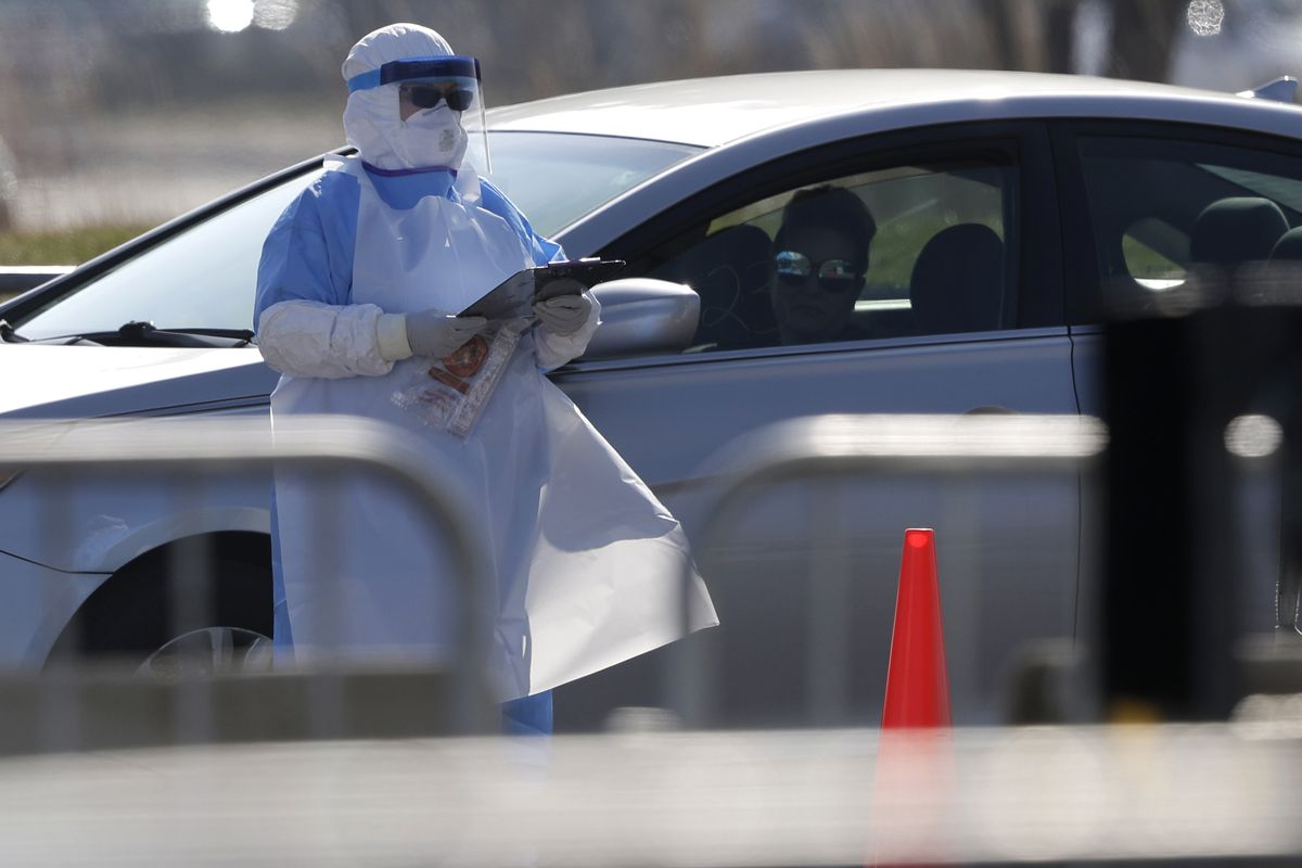 Medical personnel at a federal COVID-19 drive-thru testing site in the parking lot of Walmart in North Lake, Ill., Wednesday, March 25, 2020. The new coronavirus cause mild or moderate symptoms for most people, but for some, especially older adults and people with existing health problems, it can cause more severe illness or death. (AP Photo/Nam Y. Huh) ORG XMIT: ILNH133