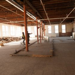 """Looking toward the back of the space, where there will be a """"Little League banquette"""" for groups. The wood on the floor outlines the bar."""