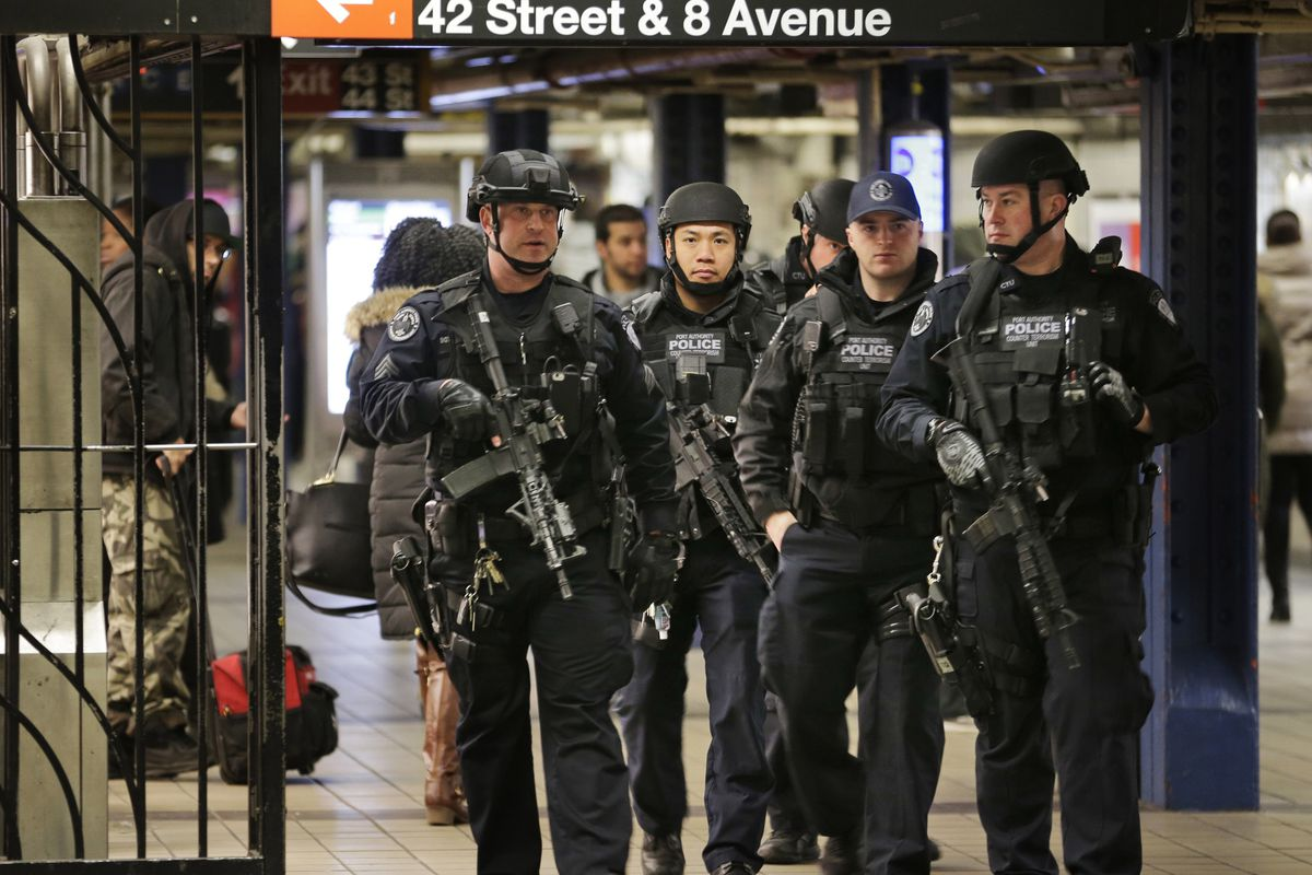 In this Dec. 12, 2017 file photo, police officers patrol in the passageway connecting New York City's Port Authority bus terminal and the Times Square subway station, near the site of an explosion the previous day. Akayed Ullah, a Bangladeshi immigrant whose subway pipe bomb mostly misfired, was sentenced Thursday, April 22, 2021, to life in prison for the 2017 attack in New York City busiest station.