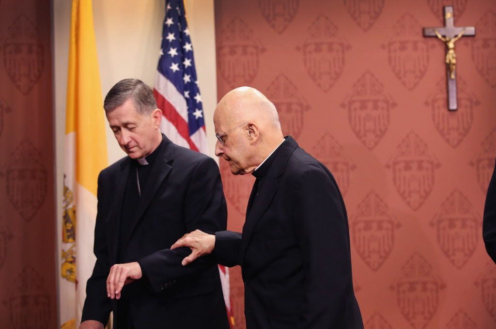 Future Cardinal Blase Cupich (left) helping Cardinal Francis George from the lecturn on Sept. 20, 2014, in Chicago after being named by Pope Francis to succeed George. | Getty Images