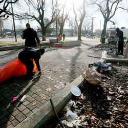 Health department officials clean up a homeless camp at Taufer Park in Salt Lake City with the help of Utah Highway Patrol troopers and Salt Lake City police officerson Tuesday, Dec. 10, 2019.