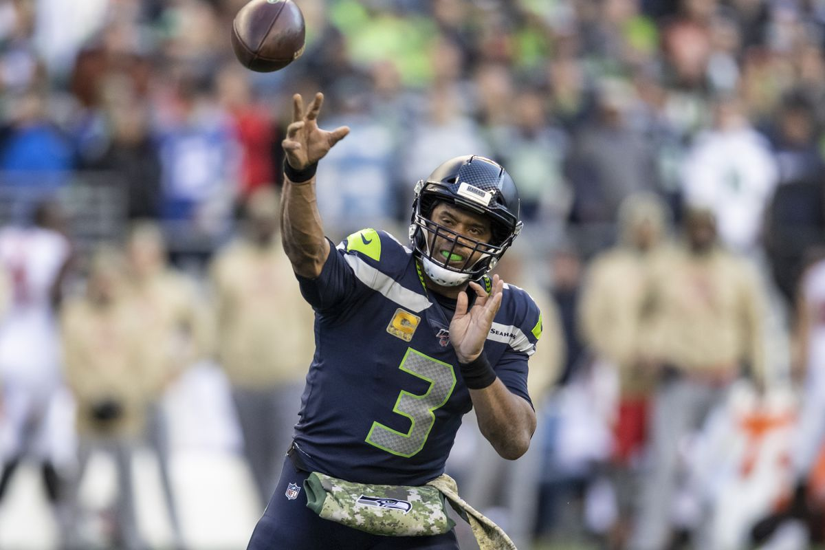 Quarterback Russell Wilson of the Seattle Seahawks passes the all during a game against the Tampa Bay Buccaneers at CenturyLink Field on November 3, 2019 in Seattle, Washington.
