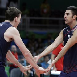 United States' Taylor Sander, right, celebrates with teammate Murphy Troy during a men's preliminary volleyball match against Mexico at the 2016 Summer Olympics in Rio de Janeiro Monday, Aug. 15, 2016.