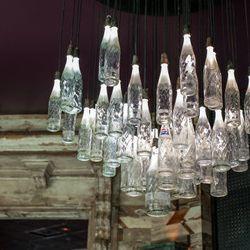Custom chandelier made out of antique Pepsi bottles.