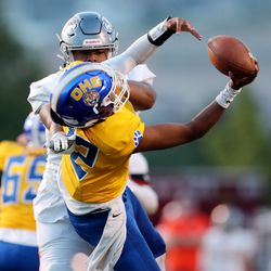 Skyridge's Stone Mulitalo knocks Orem's quarterback Micah Fe'a down before he can throw the ball as the two teams play in a high school football game in Lehi on Friday, Aug. 28, 2020.