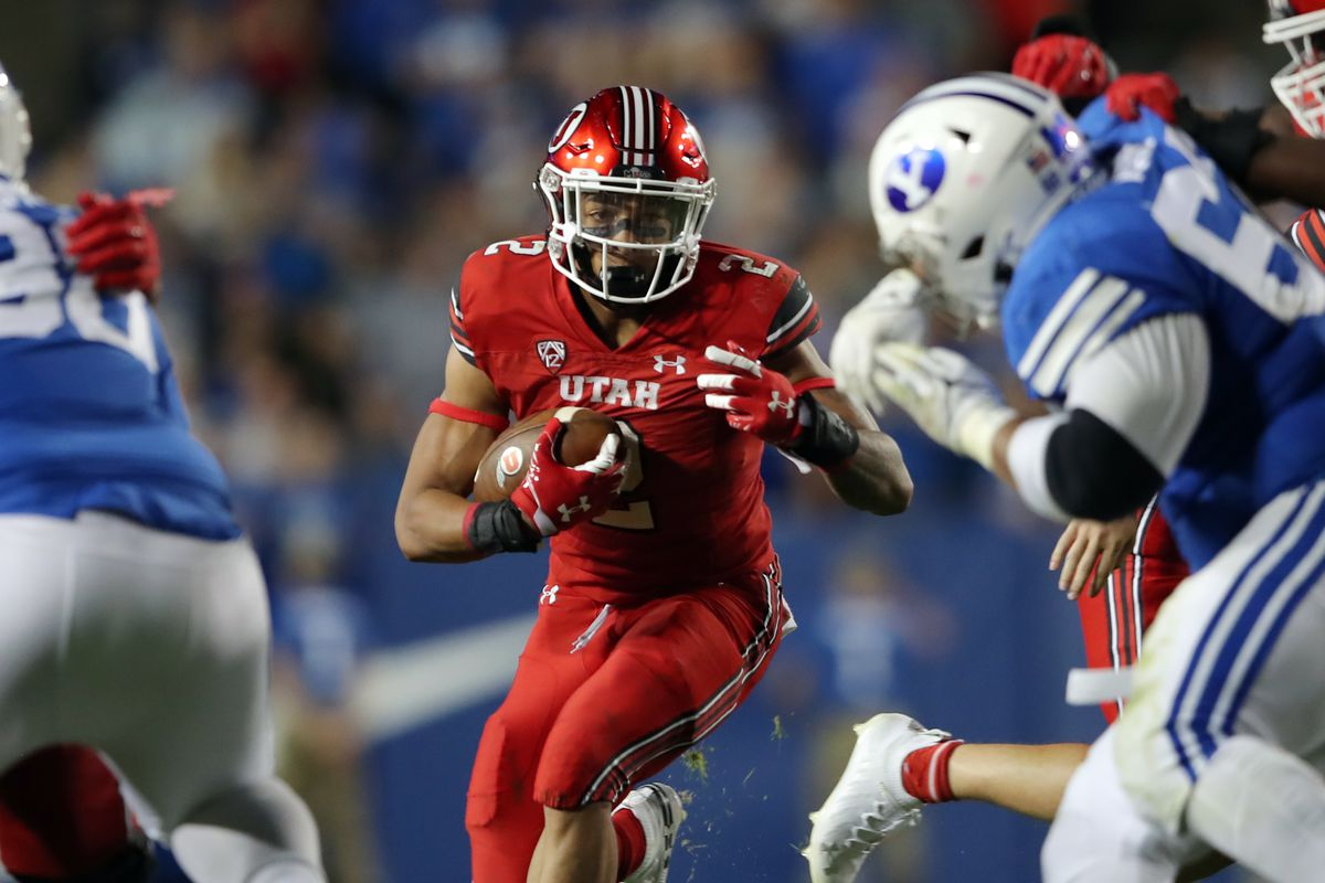 Utah Utes running back Micah Bernard (2) finds an opening in the line as BYU and Utah play an NCAA football game at LaVell Edwards Stadium in Provo on Saturday, Sept. 11, 2021. BYU won 26-17, ending a nine-game losing streak to the Utes.