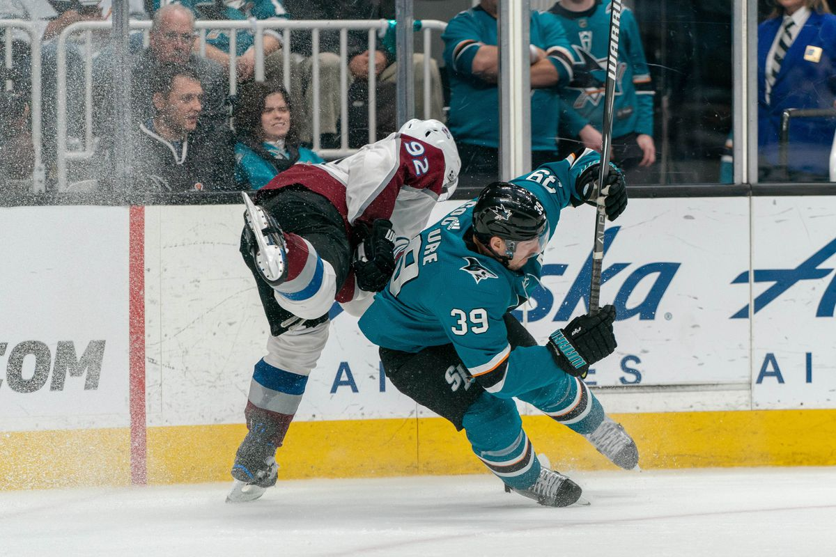San Jose Sharks center Logan Couture (39) is upended by Colorado Avalanche left wing Gabriel Landeskog (92) during the third period in game one of the second round of the 2019 Stanley Cup Playoffs at SAP Center at San Jose.