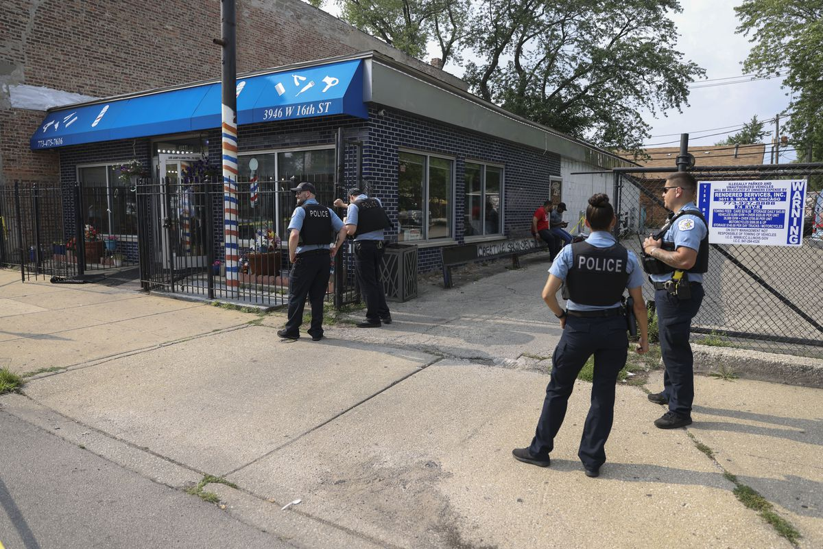 Police stand outside of barbershop at 3946 W 16th St in Lawndale where two men were shot , Wednesday, July 28, 2021. | Anthony Vazquez/Sun-Times