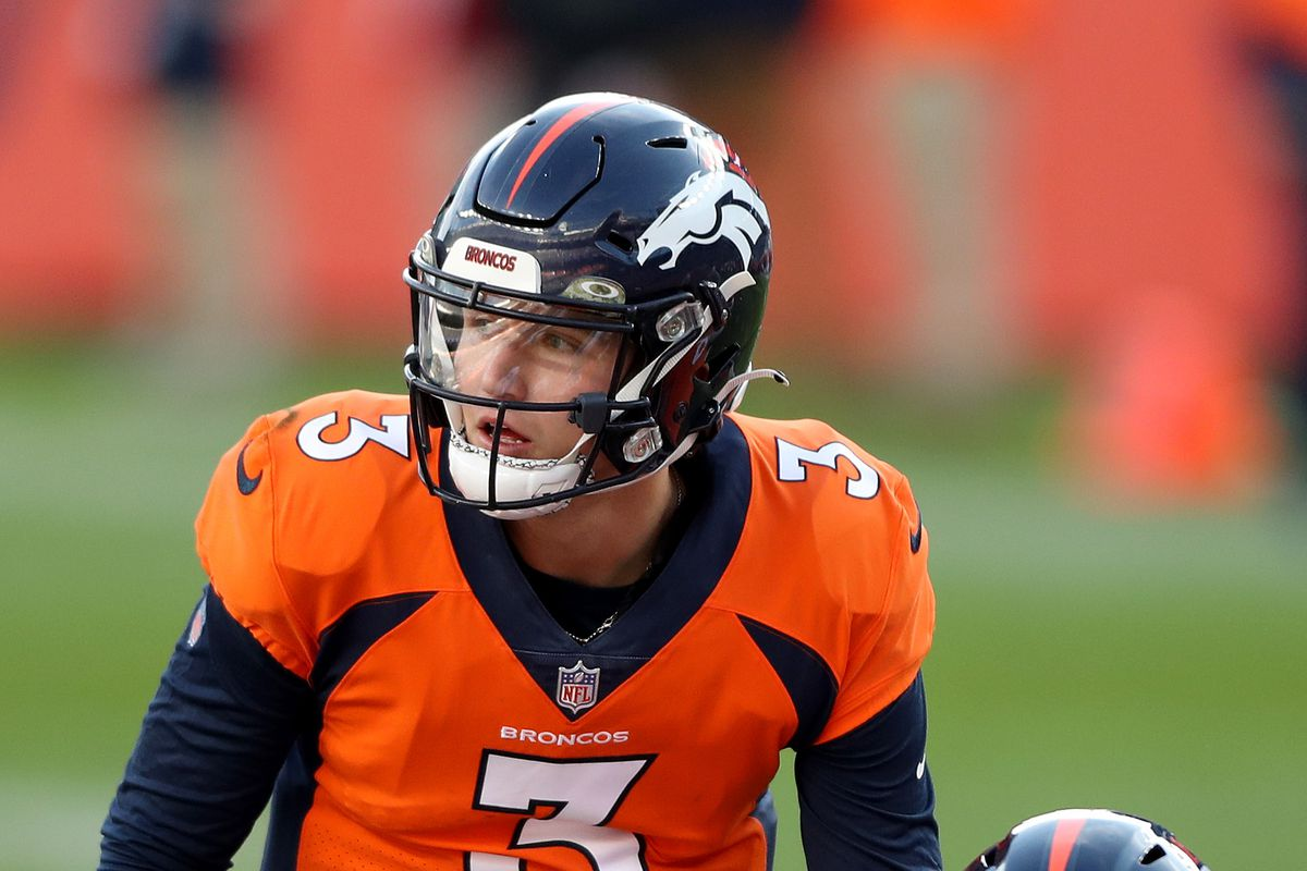 Drew Lock #3 of the Denver Broncos calls a play at the line of scrimmage with Lloyd Cushenberry #79 in front of Zach Sieler #92 of the Miami Dolphins during the second quarter at Empower Field At Mile High on November 22, 2020 in Denver, Colorado.