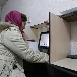 """In this picture taken on Monday, Feb. 13, 2012, an Iranian woman uses a computer in an internet cafe in central Tehran, Iran.  Iran calls it the """"soft war"""" with the West: Battles to control, defend and monitor the web and telecommunications. The latest move came from the Revolutionary Guard, launching what they claim is a hack-proof phone network for high-level commanders. Tehran's efforts to build a cyber-fortress have become a priority among leaders fearful of Internet espionage and virus attacks from abroad and seeking to choke off opposition voices at home."""