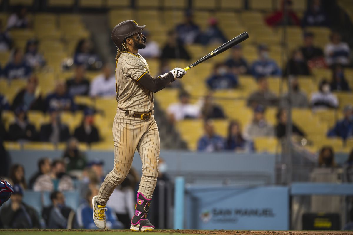 Fernando Tatis Jr. #23 of the San Diego Padres hits a home run in the fifth inning against the Los Angeles Dodgers on April 23, 2021 at Dodger Stadium in Los Angeles, California.